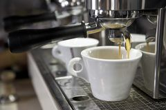 Espresso cup on the background of coffee machines royalty free stock photos