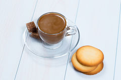 Espresso cup of black coffee with sugar and cookies. On a wood table Royalty Free Stock Images