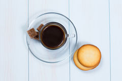 Espresso cup of black coffee with sugar and cookies. On a wood table Royalty Free Stock Photos