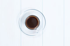 Espresso cup of black coffee. On a wood table Stock Photography