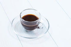 Espresso cup of black coffee. On a wood table Stock Image