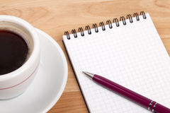 Espresso cup with blank notepad and pen Stock Photo