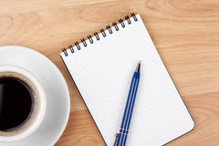 Espresso cup with blank notepad and pen Stock Photos