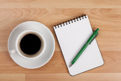 Espresso cup with blank notepad and pen Royalty Free Stock Photo