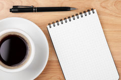 Espresso cup with blank notepad and pen Royalty Free Stock Image