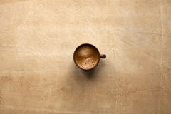 Espresso cup on brown. Table. Free space for text Royalty Free Stock Image