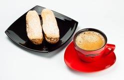 Espresso cup and cake Stock Photos