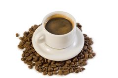 Espresso cup on coffee beans Royalty Free Stock Images