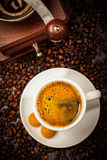 Espresso cup in coffee beans Stock Photos