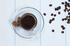 Espresso cup of coffee, sugar and beans. On a wood table Stock Images