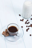 Espresso cup of coffee, sugar and milk. On a wood table Stock Images
