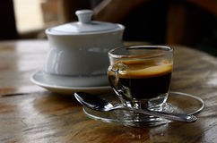 Espresso. Cup of coffee on wooden table stock photography
