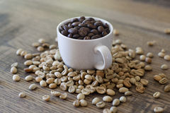 Espresso cup filled with coffee beans Stock Photos