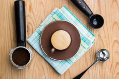 Espresso cup with handle, metal spoon and tamper Stock Photography