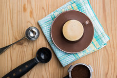 Espresso cup with handle, metal spoon and tamper Stock Photos