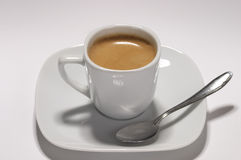 Espresso cup. Little white espresso coffee cup on a white saucer over white background Stock Photography