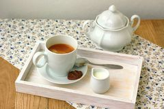 Espresso in the cup with milk, biscuit and sugar basin Royalty Free Stock Images