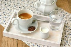 Espresso in the cup with milk, biscuit and sugar basin Royalty Free Stock Photos