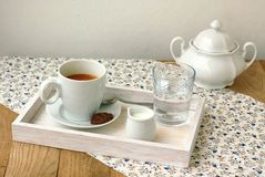 Espresso in the cup with milk, biscuit and sugar basin Royalty Free Stock Photo
