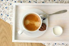 Espresso in the cup with milk, biscuit and sugar basin Stock Photos