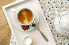 Espresso in the cup with milk, biscuit and sugar basin Stock Image