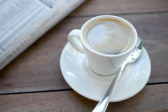 Espresso cup and newspaper Stock Image