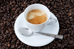 Espresso cup and Roasted Coffe Royalty Free Stock Photography