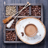 Espresso cup and vintage box with coffee beans Royalty Free Stock Photos