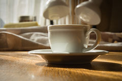 Espresso cup. On a wooden table in the sunlight Royalty Free Stock Photography