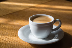 Espresso cup. On a wooden table in the sunlight Stock Images