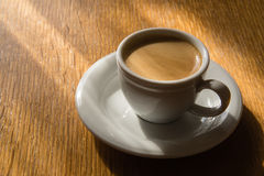 Espresso cup. On a wooden table in the sunlight Stock Photo