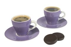 Espresso Cups. Two espresso cups with dark chocolate mints Royalty Free Stock Image