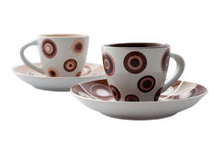 Espresso Cups and Saucers. Espresso coffee cups and saucers on an isolated white background with a shallow depth of field including a clipping path Royalty Free Stock Photography