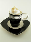 Espresso in demitasse. A chocolate colored demitasse set Stock Photography
