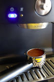Espresso Dose. Part of espresso machine with filter holder full of a coffee dose stock photography