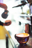 Espresso expresso italian coffee cup with machine. And barista Stock Image
