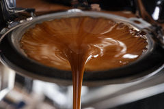 Espresso extraction with bottomless portafilter. Close up Royalty Free Stock Images