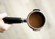 Espresso filter holder. Hand holding an espresso filter holder Royalty Free Stock Photography