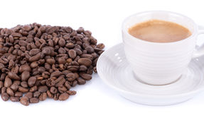 Espresso with foam and coffee beans Royalty Free Stock Photos