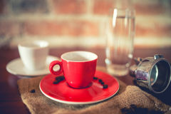 Espresso freshly brewed from coffee machine in pub, restaurant. Fresh coffee with details on vintage edit Stock Images