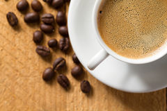 Espresso with froth on wooden table Royalty Free Stock Images