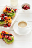Espresso and fruit dessert sandwiches with ricotta cheese, kiwi, apricot, strawberry, blueberry and red currant Stock Image