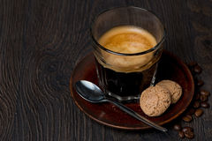 Espresso in a glass and almond cookies Stock Photos