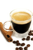 Espresso in a glass cup with cinnamon and beans Stock Image