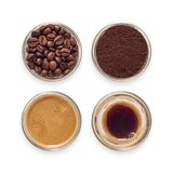 Espresso glasses filled with coffee. Espresso glasses filled with beans, ground coffee and freshly brewed coffee Stock Photos