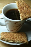 Espresso and Graham Crackers. Close up shot of a hot cup of espresso served with crispy graham crackers Royalty Free Stock Photo