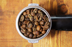 Espresso handle. An espresso handle filled with ground coffee Stock Photography