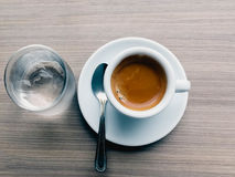 Espresso hot coffee glass of water Stock Image