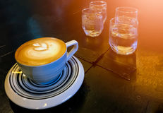 Espresso hot coffee glass of water Stock Photo