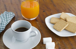 Espresso, juice and cookies Stock Photography